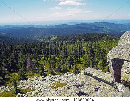 Krkonose mountains view scenery with granite rock and spruce tree forest