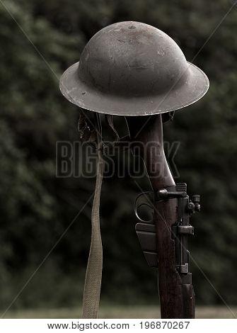 World war era rifle and Brodie helmet