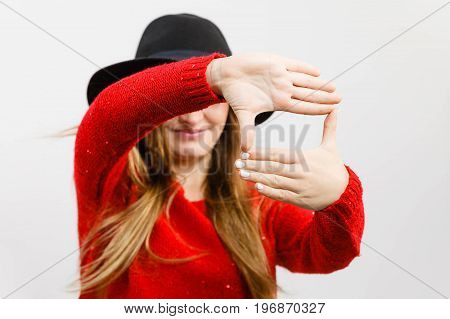 Young Lady Making Camera Gesture.