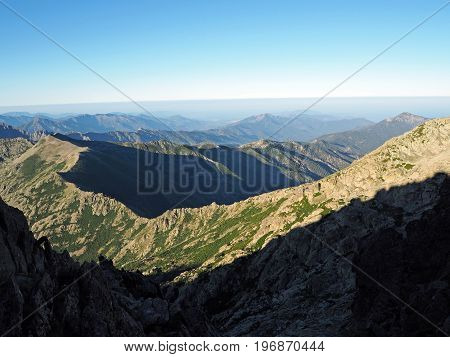 Wiew From The Top To The The Mountain Belt Scenery With The Blue Sky Background