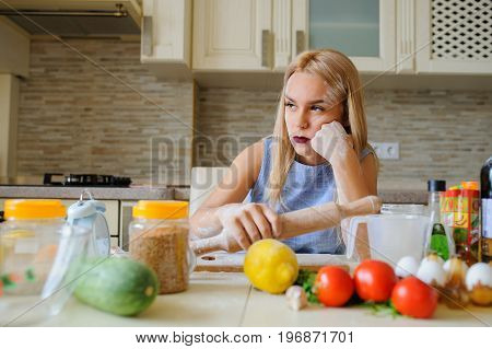 Young Desperate Housewife In Her Kitchen