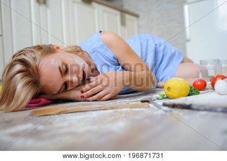 Desperate Housewife Lying On The Floor In Her Kitchen