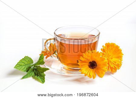 Tea with marigold and mint on a white background.