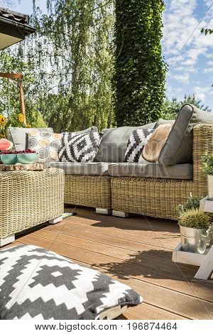 House terrace with modern garden furniture with pillows