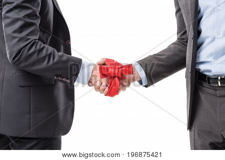 Cropped Shot Of Business People Shacking Hands With Red Bow On Hands Isolated On White