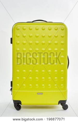 Close up of large suitcase. Suitcase for travelling isolated on white.