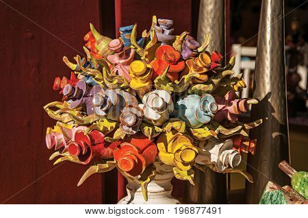 Paraty, Brazil - January 25, 2015. Colorful wooden sculpture of flowers in Paraty, an amazing and historic town totally preserved in the coast of the Rio de Janeiro State, southwestern Brazil