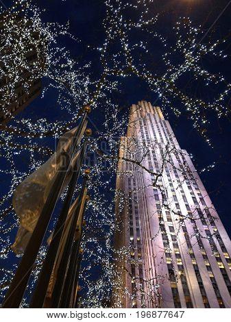 NEW YORK CITY: DEC 20, 2013 - Upward view of 30 Rockefeller Plaza at Christmas time.