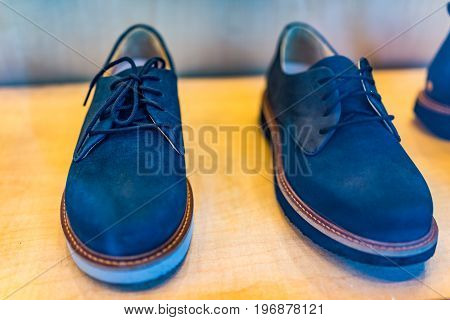 Pair of blue mens shoes on display