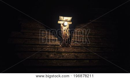 Hand Crafted Lamp On House Roof