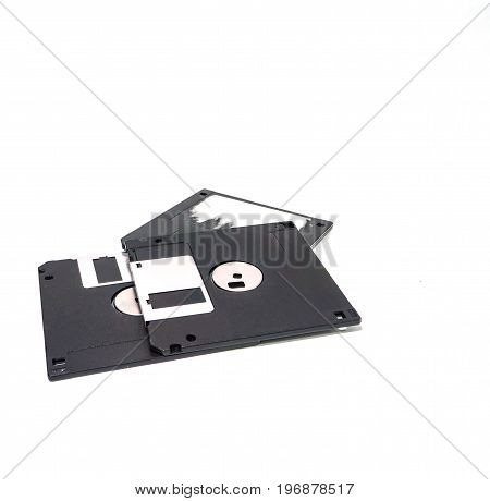 Stack of old storage diskette floppy disk on white background