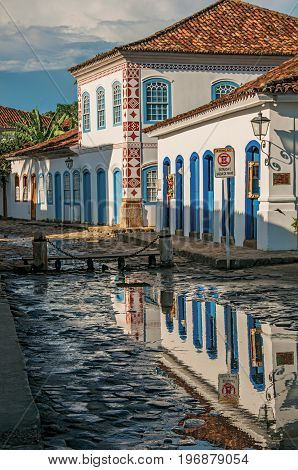 Overview of flooded cobblestone street with old houses at the sunset in Paraty, an amazing and historic town totally preserved in the coast of the Rio de Janeiro State, southwestern Brazil