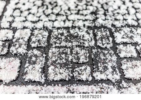 Macro Closeup Of Doormat Covered In Winter Snowflakes