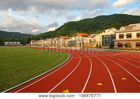 Turf Track and Field With unique architecture and beautiful hillside forrest view