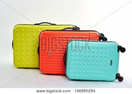 Set of bright wheeled suitcases. Valises for tourists relocation.