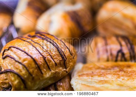 Macro Closeup Of Many Chocolate Drizzled Croissants