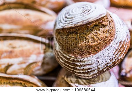 Closeup Of Circular Sourdough Baked Bread Loaf In Bakery