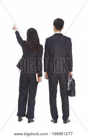 young asian business man and woman pointing to the distance rear view isolated on white background.