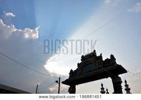 Morning sunshine showing the 3 different layers of sunray on top of a Indian kuil.