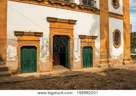 View of old colored church doors and cobblestone street in Paraty, an amazing and historic town totally preserved in the coast of the Rio de Janeiro State, southwestern Brazil