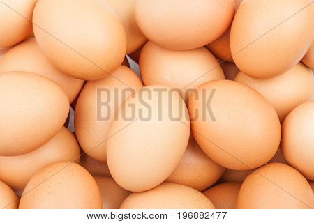 Background with fresh brown chicken eggs close-up