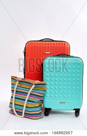 Suitcases and textile handbag. Modern traveler accessories.