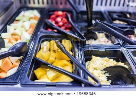 Fruit Salad Bar With Pineapple And Melon