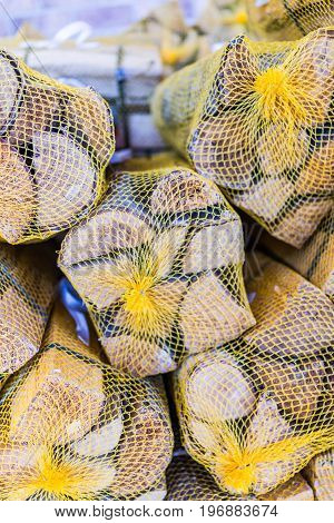 Wooden logs wrapped in mesh on display