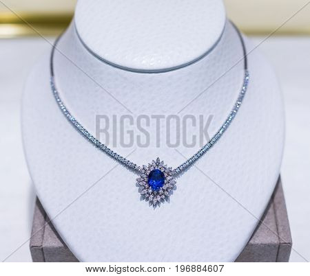 Blue diamond sapphire necklace on mannequin on display