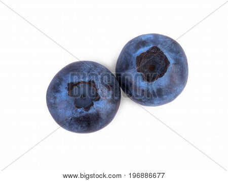 Two whole and fresh blueberries isolated over the white background. A top view of a juicy and ripe bright blueberry. Summer fruits. Fantastic ingredients for organic homemade meals.