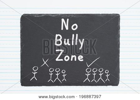 No Bully Zone hand lettering text on a weathered chalkboard with retro lined paper
