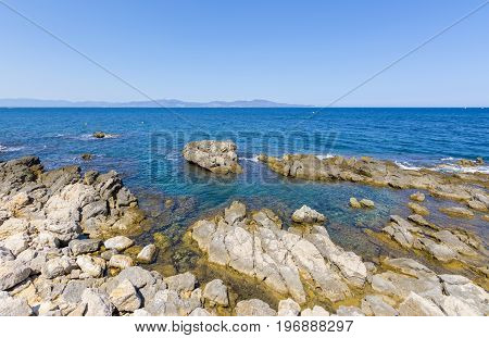 Rocky Mediterranean coast of l'Escala village in Costa Brava, Spain.