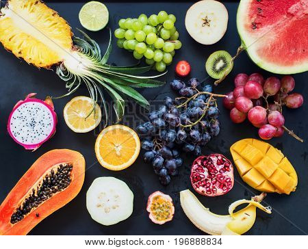 Top View Set Tropical Cut Fruits Black Background
