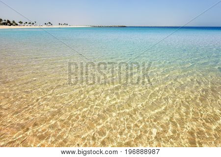 Tropical Beach Seen From Crystal Clear Water