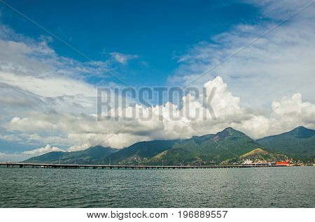 Overview of sea, mountain landscape of Ilhabela island, port and ships in São Sebastião, a nice seaside town with several tropical beaches close by. Located in the São Paulo State, southwestern Brazil
