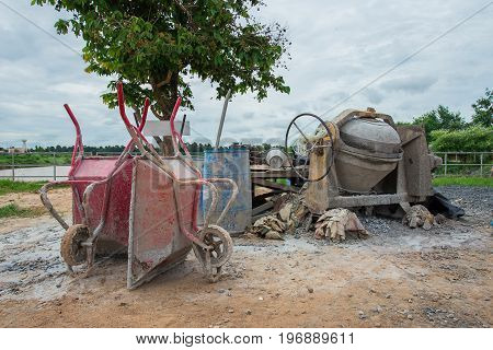 Construction Worker Mixing Cement in construc side