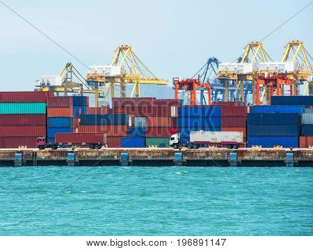 container ship in import export and business logistic.By crane Trade Port Shipping cargo to harbor Aerial view Top view.