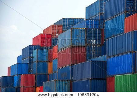 container ship in import export and business logistic.By crane Trade Port Shipping cargo to harbor