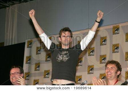 """SAN DIEGO, CA - JULY 26: Actor David Tenant (C) star of BBC's """"Dr. Who,"""" attends the 40th annual San Diego Comic Con International held July 26, 2009 in San Diego, CA."""