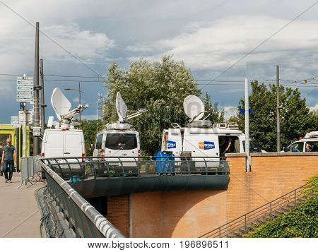 STRASBOURG FRANCE - JUN 30 2017: RTL N:TV TV Media Television Trucks with multiple Satellite parabolic antennas and fiber optic cables preparing to report live the official European Ceremony of Honour for Dr. Helmut Kohl at European Parliament
