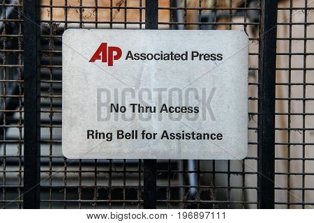 LONDON UNITED KINGDOM - MAR 9 2017: Associated Press - the international Press Agency security door entrance with message No Thru Access and Ring Bell for Assistance.