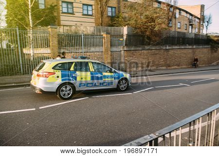 LONDON UNITED KINGDOM - MAR 9 2017: British London Metropolitan police car driving fast on London street to an ongoing crime scene accident or other kind of terrorist suspect attack