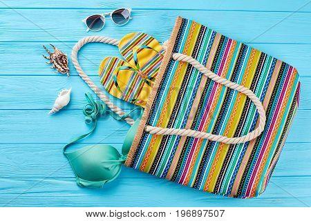 Bright accessories for marine beach. Sea vacation still life.