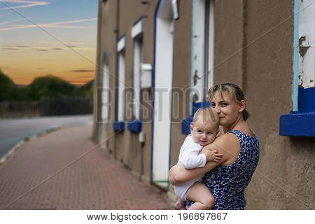 happy and confident mother, clinging to her frightened little child