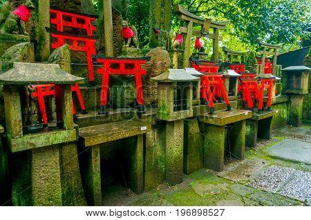 KYOTO, JAPAN - JULY 05, 2017: Torii gates of Fushimi Inari Taisha shrine in Kyoto, Japan. There are more than 10, 000 torii gates at Fushimi Inari.