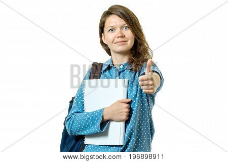 Portrait Of A Beautiful Young Student Girl Showing Thumbs Up