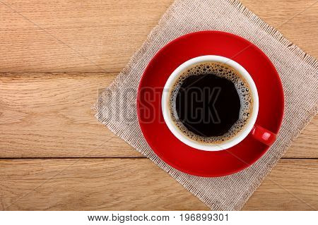 Full Cup Of Black Coffee In Red Cup On Table