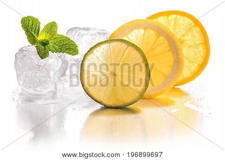 Ice cubes and slice of lemon lime and orange with mint leaf on white background