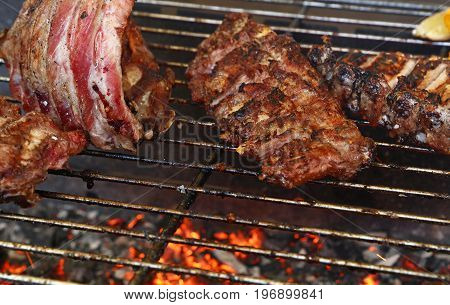 Racks Of Pork Spare Ribs On Fire Barbecue Grill
