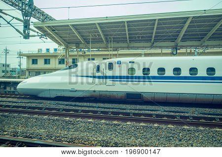 KYOTO, JAPAN - JULY 05, 2017: JR700 shinkansen bullet train departing Kyoto station in Kyoto, Japan.